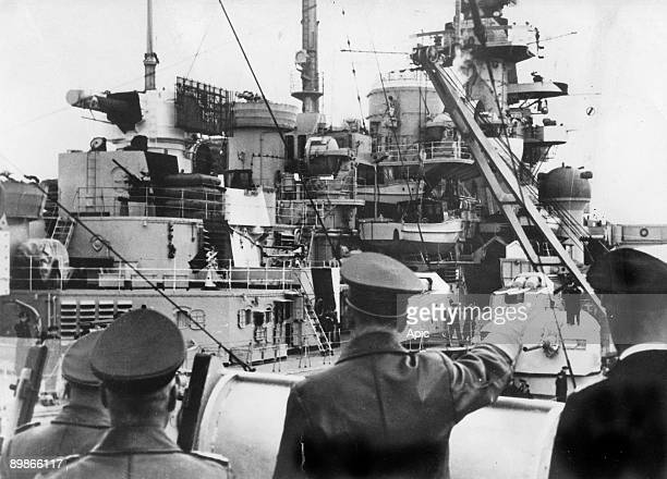 Adolf Hitler with captain Lindemann behind him admiral Gunther Lutjens and general Wilhelm Keitel aboard battleship Bismarck may 5 1941 one hour...