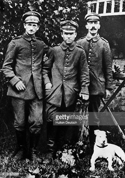 Adolf Hitler with fellow foot soldiers in 1914, during World War I.