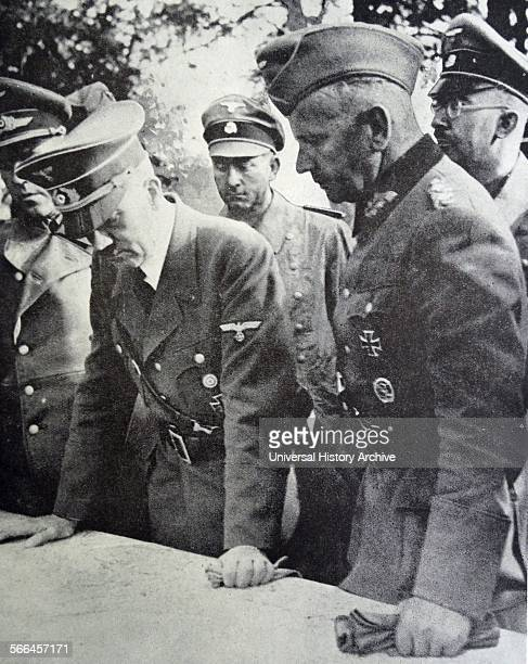 Adolf Hitler with General Walther von Reichenau at a map briefing during the Invasion of Poland, September 1939. At far right is Reichsführer-SS...