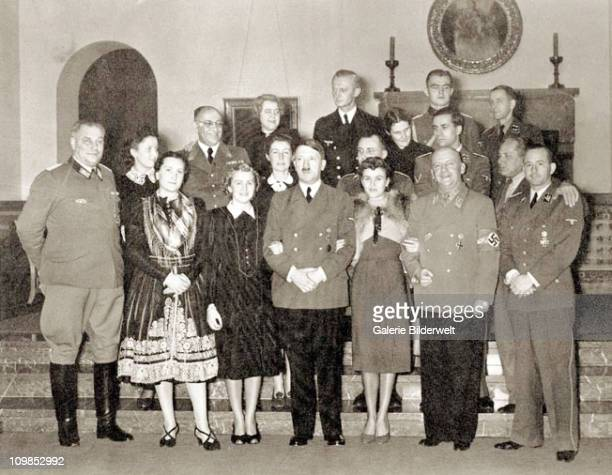 Adolf Hitler with guests at at his residence the Berghof near Berchtesgaden Germany 31st December 1939 Front row left to right Wilhelm Bruckner...