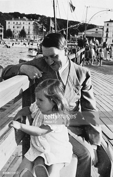 Adolf Hitler with Helga Goebbel daughter of Reich minister of Propaganda Joseph Goebbels Weimar Republic