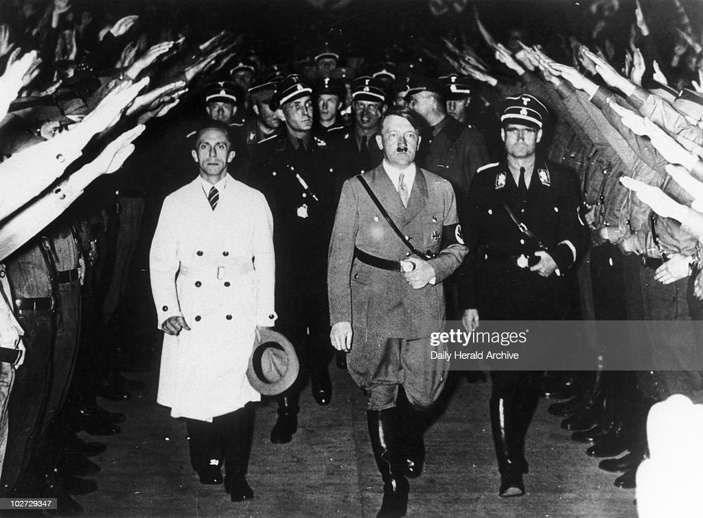 Adolf Hitler with Hess and Goebbels, c 1939-1945.' 'Adolf Hitler seen with Rudolf Hess and Minister Goebbels, left, arriving at the sports palace in Berlin to open his election campaign'.'
