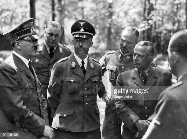 Adolf Hitler with Himmler. From Eva Braun's album.