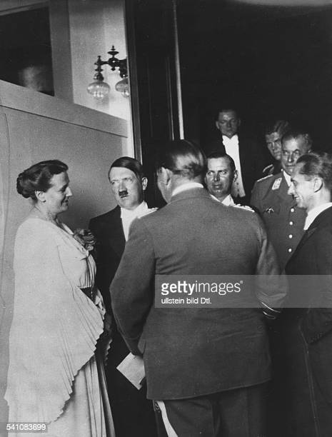 Adolf Hitler*20.04.1889-+Politician, Nazi Party, GermanyA.H. Talking to Winifred Wagner in the foyer of the Bayreuth Festspielhaus during an...