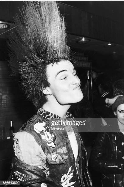 Adolf of North London celebrating the tenth anniversary of the Sex Pistols in a West End basement venue Hairstyles were gelled and teased into Dayglo...