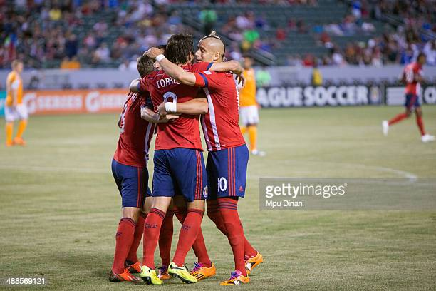Adolfo Bautista and other members of Chivas USA congratulate Erick Torres after he scored a goal against the Houston Dynamo on May 3 2014 at StubHub...