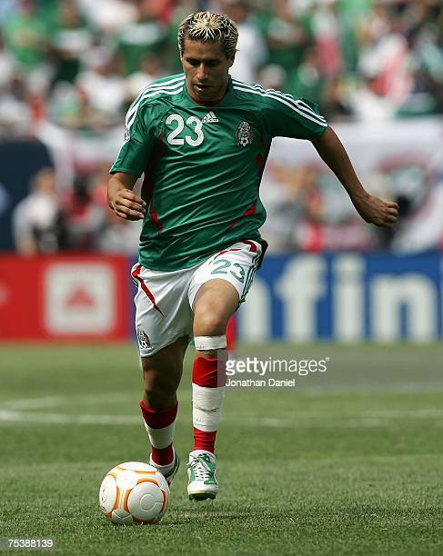 Adolfo Bautista of Mexico moves the ball against the USA during the CONCACAF Gold Cup Final match at Soldier Field on June 24 2007 in Chicago...