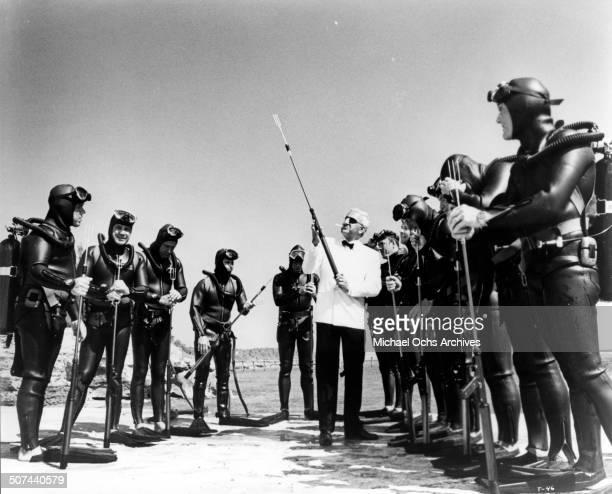 Adolfo Celi as Largo handles a harpoon in a scene from the movie 'Thunderball' circa 1965