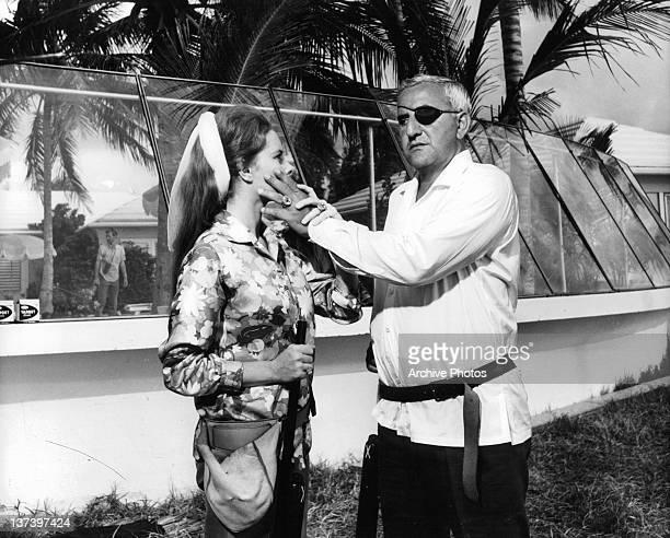 Adolfo Celi has his hand over Luciana Paluzzi in a scene from the film 'Thunderball', 1965.