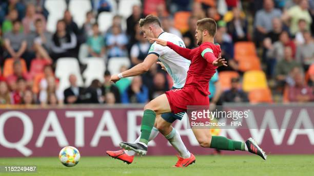 Adolfo Gaich of Argentina battles for possession with Diogo Queiros of Portugal during the 2019 FIFA U20 World Cup group F match between Portugal and...
