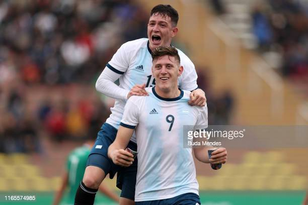 Adolfo Gaich of Argentina celebrates after scoring the first goal of his team with teammate Agustín Urzi during Men´s football First Round Group A...