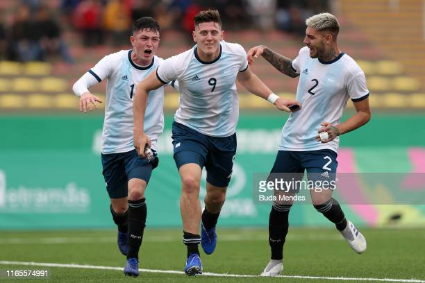 Adolfo Gaich of Argentina celebrates after scoring the first goal of his team with teammate Agustín Urzi and Julio Mosevich during Men´s football...