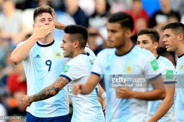 Adolfo Gaich of Argentina celebrates scoring the opening goal during the 2019 FIFA U20 World Cup group F match between Portugal and Argentina at...