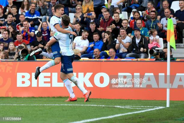 Adolfo Gaich of Argentina celebrates scoring the opening goal with Julian Alvarez during the 2019 FIFA U20 World Cup group F match between Portugal...