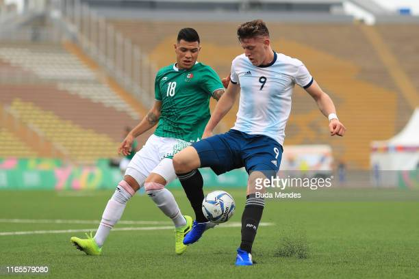 Adolfo Gaich of Argentina competes for the ball with Brayton Vazquez Velez of Mexico during Men´s football First Round Group A match between Mexico...