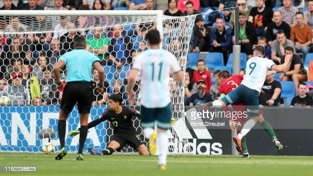 Adolfo Gaich of Argentina scores his team's first goal past Joao Virginia of Portugal during the 2019 FIFA U20 World Cup group F match between...