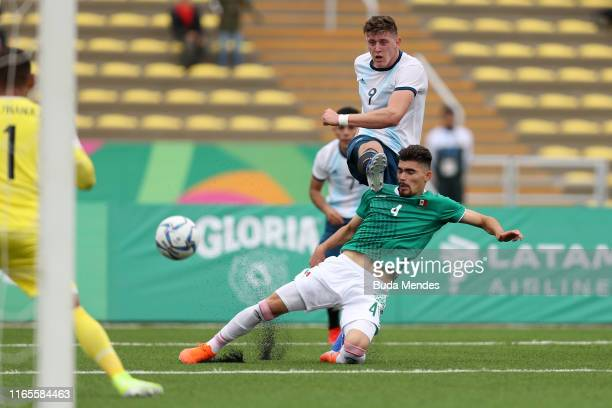 Adolfo Gaich of Argentina scores the first goal of his team during Men´s football First Round Group A match between Mexico and Argentina on Day 6 of...