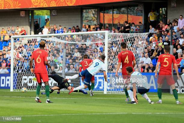 Adolfo Gaich of Argentina scores the opening goal during the 2019 FIFA U20 World Cup group F match between Portugal and Argentina at BielskoBiala...