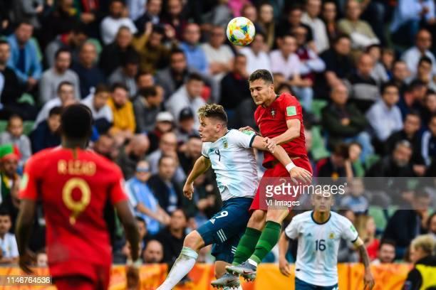 Adolfo Gaich of Argentina U20 Jose Diogo Dalot Texeira of Portugal U20 during the FIFA U20 World Cup Poland 2019 group F match between Portugal U20...