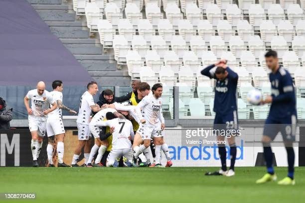 Adolfo Gaich of Benevento Calcio celebrates with team mates after scoring their side's first goal during the Serie A match between Juventus and...