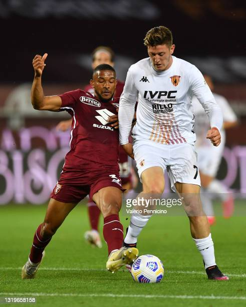 Adolfo Gaich of Benevento Calcio is put under pressure by Gleison Bremer of Torino F.C. During the Serie A match between Torino FC v Benevento Calcio...