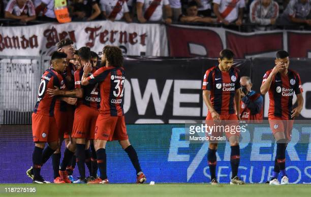 Adolfo Gaich of San Lorenzo celebrates with teammates after scoring the first goal of his team during a match between River Plate and San Lorenzo as...