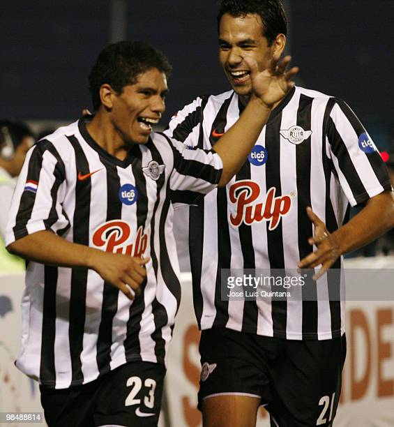 Adolfo Gama and Pedro Velazquez of Libertad celebrate second scored goal during a match against Blooming at Ramon Aguilera Costa Stadium on April 15...