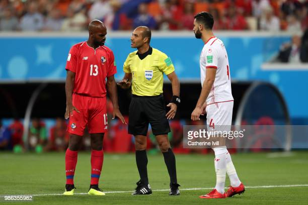 Adolfo Machado of Panama and Yassine Meriah of Tunisia discuss with Referee Nawaf Shukralla during the 2018 FIFA World Cup Russia group G match...