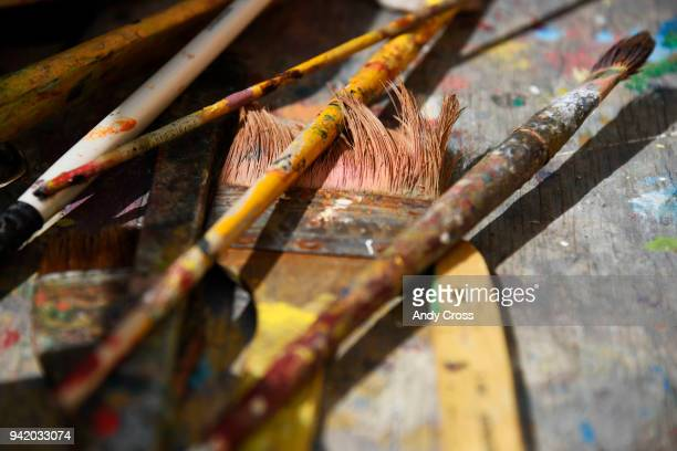 Adolfo Romero's paint brushes used to paint a mural of Oscar Zeta Acosta a Chicano lawyer writer and activist on the south side wall of Su Teatro...
