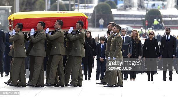 Adolfo Suarez Illana friends and relatives look on as members of the military carry the coffin of former Spanish Prime Minister Adolfo Suarez to the...