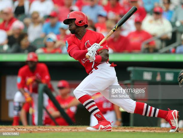Adolis Garcia of the St Louis Cardinals in action during a spring training game against the Miami Marlins at Roger Dean Stadium on March 10 2018 in...