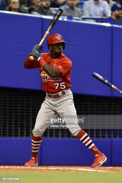 Adolis Garcia of the St Louis Cardinals prepares to bat against the Toronto Blue Jays during the MLB preseason game at Olympic Stadium on March 27...