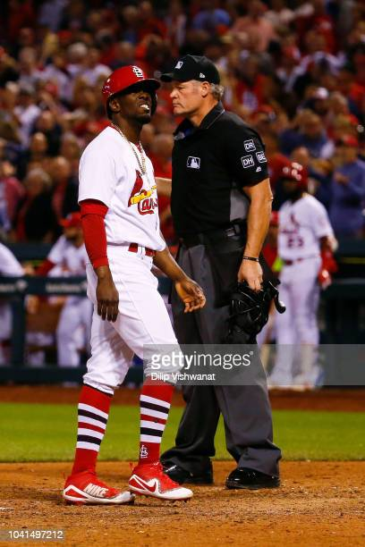 Adolis Garcia of the St Louis Cardinals reacts after being tagged out at home plate against the Milwaukee Brewers in the eighth inning as umpire Ted...
