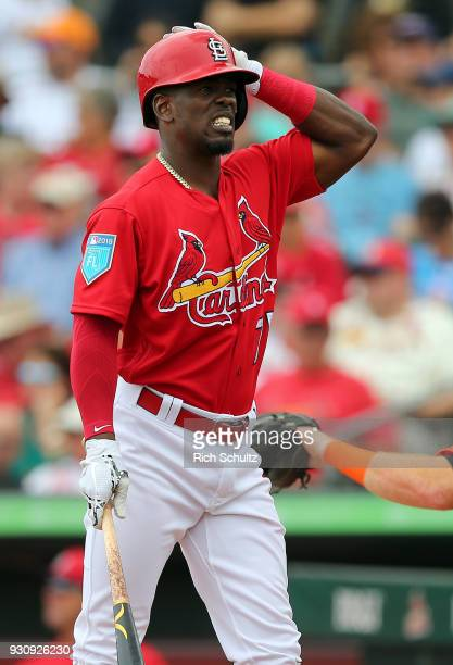 Adolis Garcia of the St Louis Cardinals reacts to an inside pitch during the third inning of a spring training game against the Miami Marlins at...