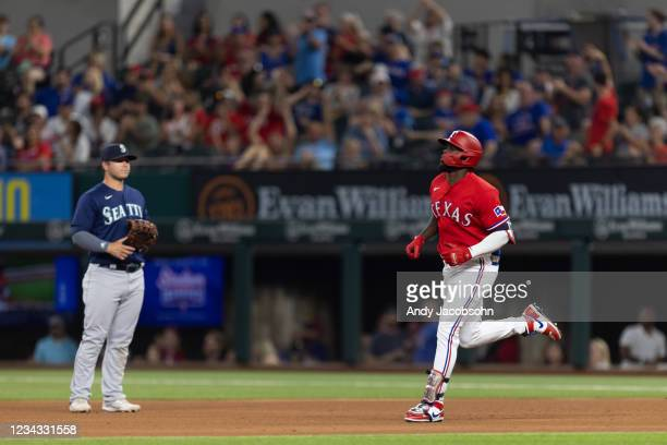 Adolis Garcia of the Texas Rangers runs the bases after hitting a home run during the sixth inning of a baseball game against the Seattle Mariners at...