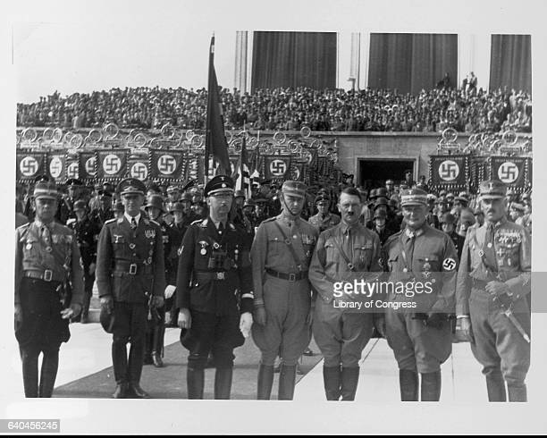 Adolph Hitler Hermann Goering and Heinrich Himmler stand with other Nazi leaders at a Party rally in Nuremberg