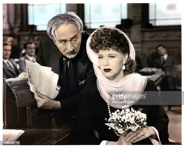 Adolphe Menjou and Ginger Rogers in court in a scene from the film 'Roxie Hart', 1942.