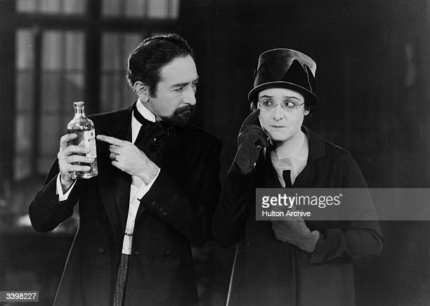 Adolphe Menjou crossexamines Florence Vidor about her eyes when they meet while both are filming Menjou is dressed for his part in 'Evening Clothes'...