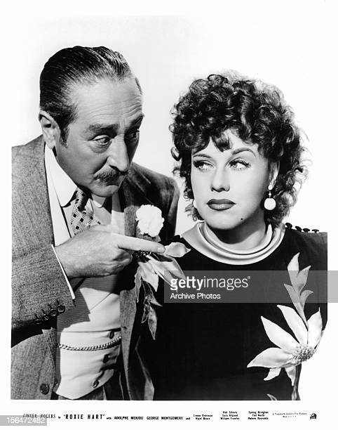 Adolphe Menjou points at Ginger Rogers in publicity portrait for the film 'Roxie Hart', 1942.
