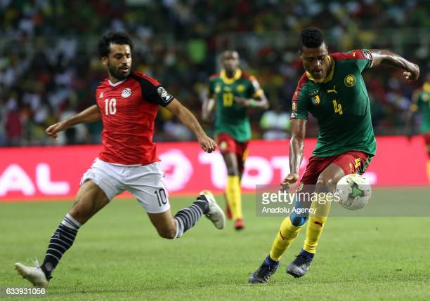 Adolphe Teikeu of Cameroon in action against Mohamed Salah of Egypt during the 2017 Africa Cup of Nations final football match between Egypt and...