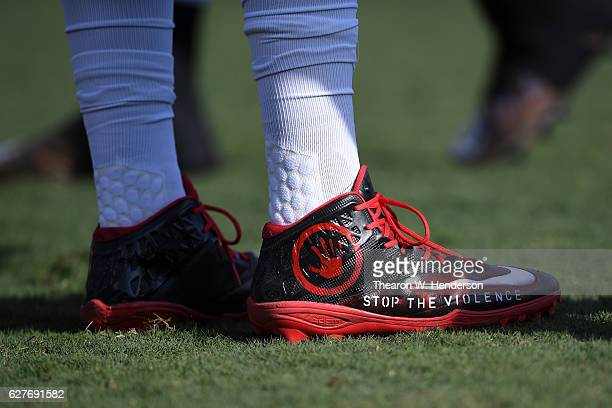 Adolphus Washington of the Buffalo Bills wear special cleats prior to their NFL game against the Oakland Raiders at Oakland Alameda Coliseum on...