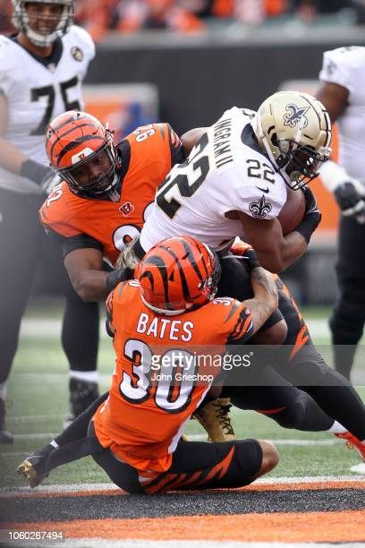 Adolphus Washington of the Cincinnati Bengals and Jessie Bates combine to tackle Mark Ingram II of the New Orleans Saints during the second quarter...