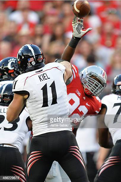 Adolphus Washington of the Ohio State Buckeyes blocks a pass attempt by Gunner Kiel of the Cincinnati Bearcats in the second quarter at Ohio Stadium...