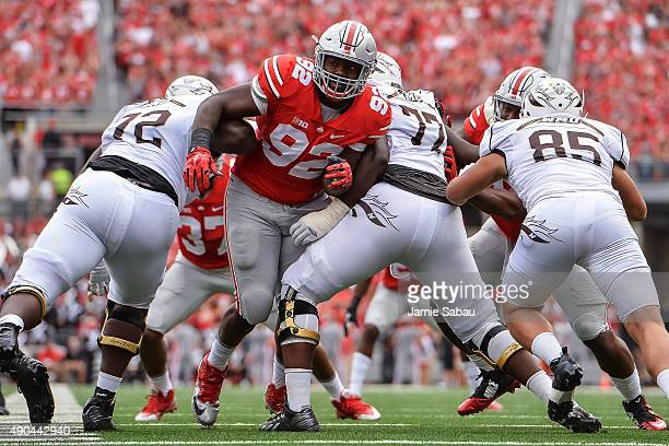 Adolphus Washington of the Ohio State Buckeyes breaks through the line against the Western Michigan Broncos at Ohio Stadium on September 26 2015 in...