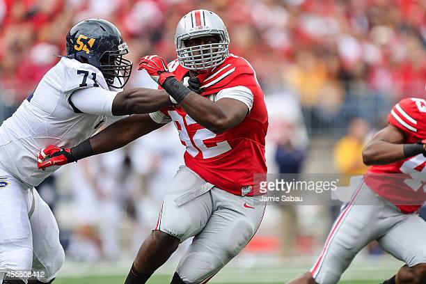 Adolphus Washington of the Ohio State Buckeyes plays on defense against the Kent State Golden Flashes on September 13 2014 in Columbus Ohio