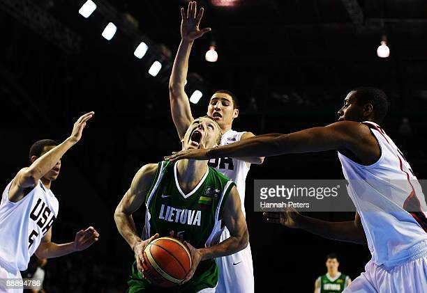 Adomas Drungilas of Lithuania is surrounded by strong United States defence from Seth Curry Terrico White and Howard Thompkins during the U19...