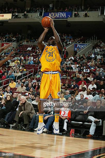 Adonal Foyle of the Golden State Warriors shoots a jumper during the game against the Philadelphia 76ers at the Wachovia Center on March 30, 2004 in...
