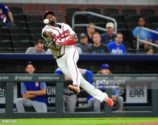 Adonis Garcia of the Atlanta Braves attempts to throw out a ninth inning runner against the New York Mets at SunTrust Park on May 2 2017 in Atlanta...