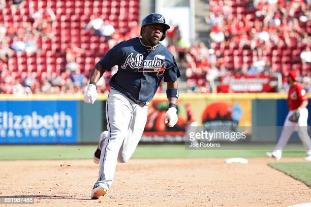 Adonis Garcia of the Atlanta Braves comes around to score a run after a single by Dansby Swanson in the fifth inning of a game against the Cincinnati...