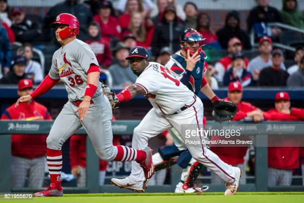 Adonis Garcia of the Atlanta Braves gets a tag out against the St Louis Cardinals at SunTrust Park on May 05 2017 in Atlanta Georgia The Cardinals...